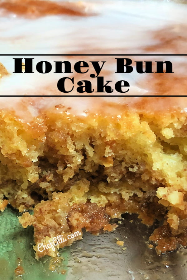 Up close photo of a pan of honey bun cake where a piece has been lifted out.