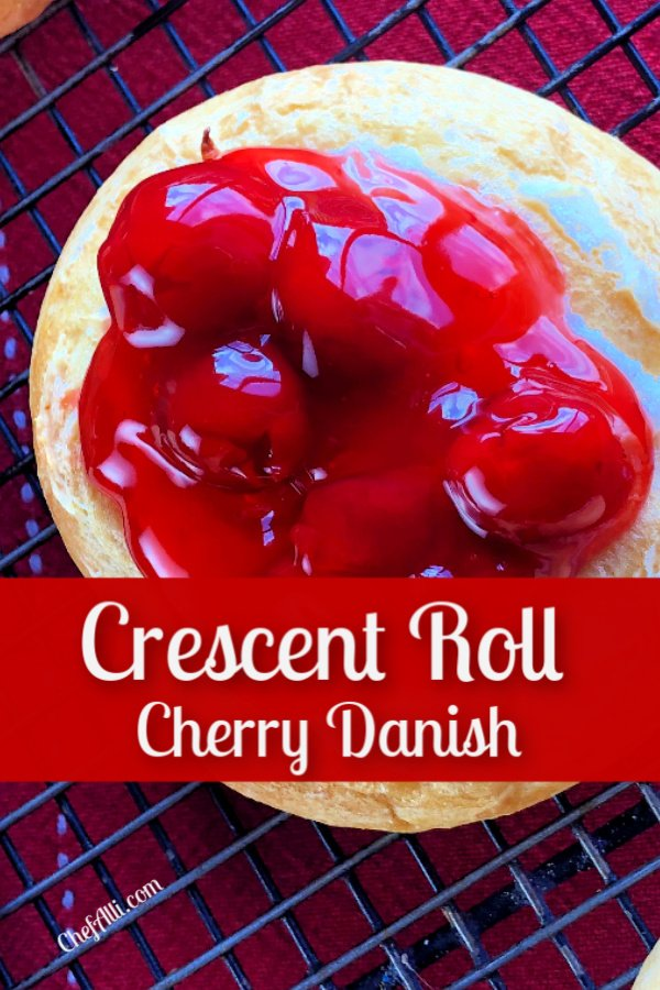 A danish topped with cherry filling.