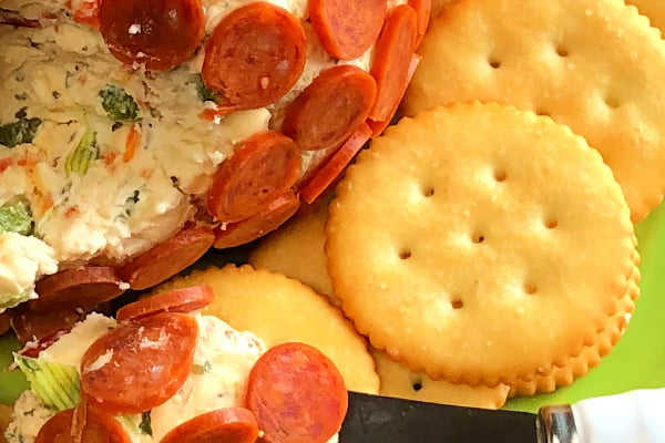 Do you love the flavors of pepperoni pizza? Our Pepperoni Pizza Cheese Ball is just a few ingredients, makes a delicious any-time appetizer, and is super easy to make. Just add your favorite crackers and serve!