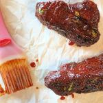 Baked Country-Style Sticky Ribs might just be your family's favorite new way to eat pork! Fall-apart-tender, no bones, and a deliciously wicked and sticky bbq sauce make this cut of pork a great alternative to traditional ribs...especially since they are so ridiculously cheap and easy to make. #stickyribs #ribs #eatpork #pork #countrystyleribs