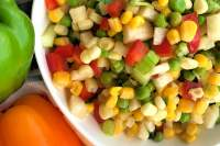 Here's a fat-free salad that's crunchy, fresh, and chock-full of vegetables. I also love how colorful this Sweet Corn and Baby Pea Salad with Jicama is. And talk about delicious on a hot summer day! #summer #salad #fresh #vegetables #crunchy #jicama #sweetcorn #babypeas
