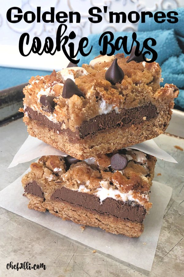 Calling all s'mores lovers!! These thick and yummy cookie bars are loaded with graham cracker flavor and oozing with warm chocolate and gooey marshmallows. We can never get enough of these Golden S'mores Cookie Bars and they are incredibly easy to make in your favorite 9 x 13 baking dish. No campfire required. :) #grahamcrackers #marshmallows #chocolate #campfire #cookies