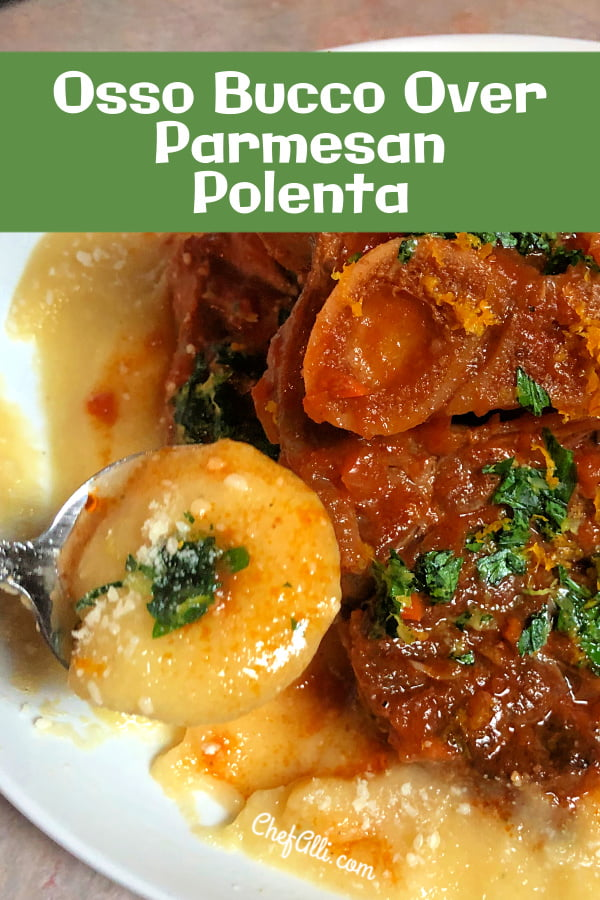 A braised pork shank Osso Bucco with sauce on a bed of parmesan polenta, garnished with gremolata.