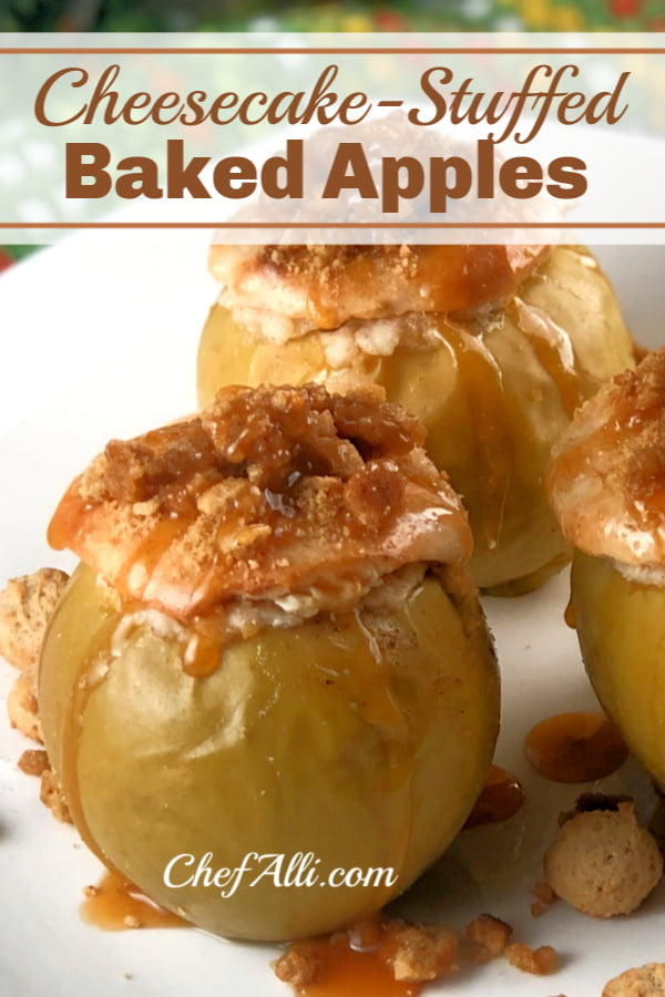 Up close shot of baked apples with cheesecake stuffing, topped with a crumble topping, resting on a white plate.