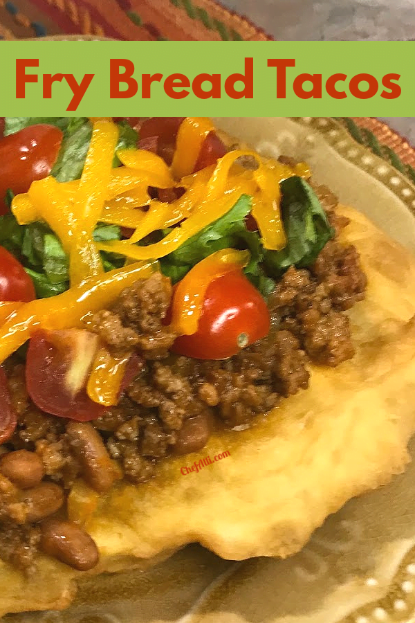 Fried bread topped with a beef and bean mixture.
