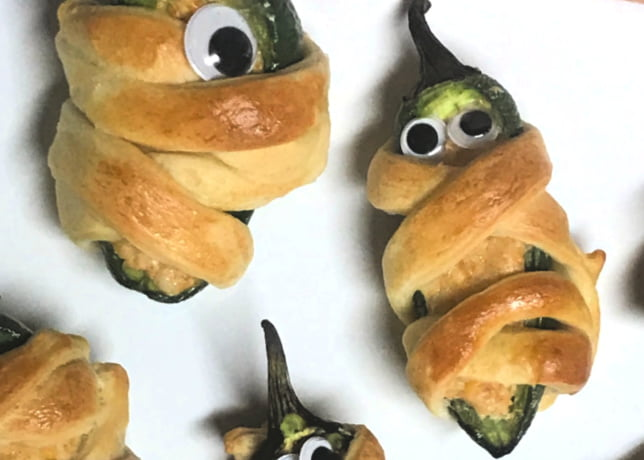 Mummy Poppers made with crescent roll dough and jalapenos.