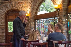 Chef Bob visits with guests at The Bistro on Park Ave