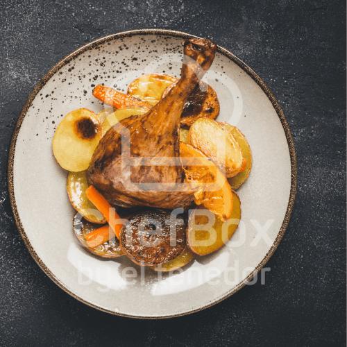 Confit duck leg, orange sauce.