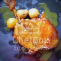Duck leg in orange sauce.