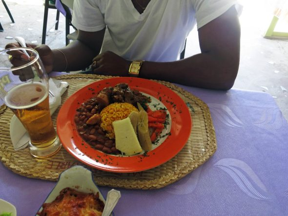 Jerk lunch with beans, rice, and breadfruit in Saint Lucia.