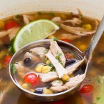 turkey tortilla soup in ladle over pot
