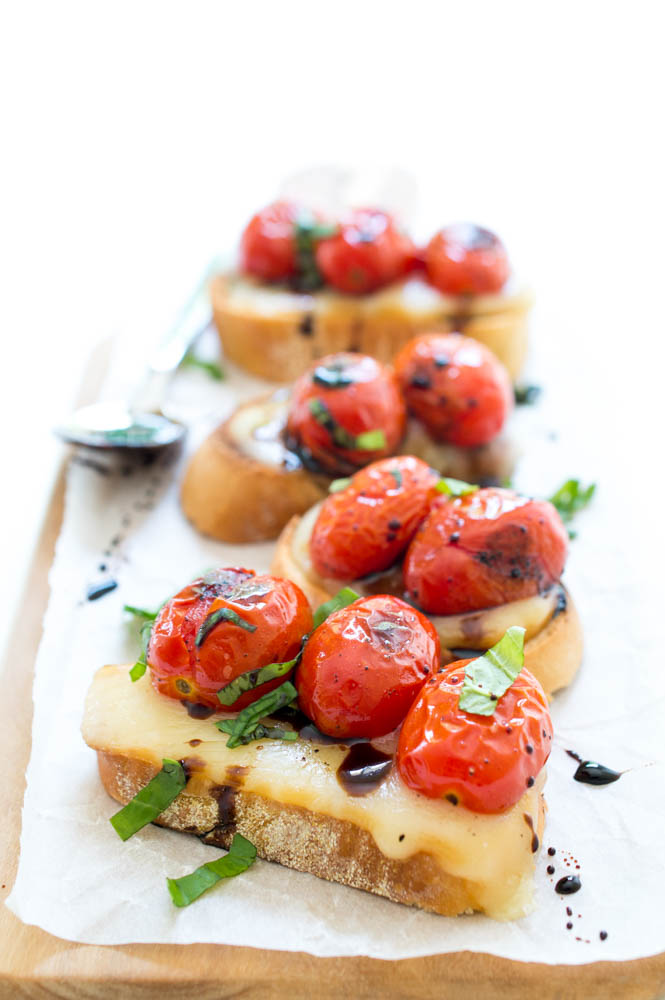 Crostini with Blistered Tomatoes and Mozzarella | chefsavvy.com #recipe #appetizer #crostini #caprese