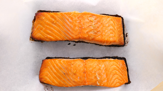 Baked salmon fillets on parchment paper