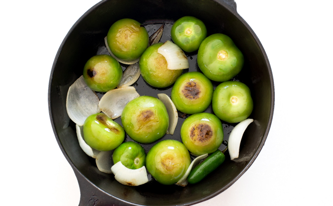 tomatillos and onions in cast iron skillet