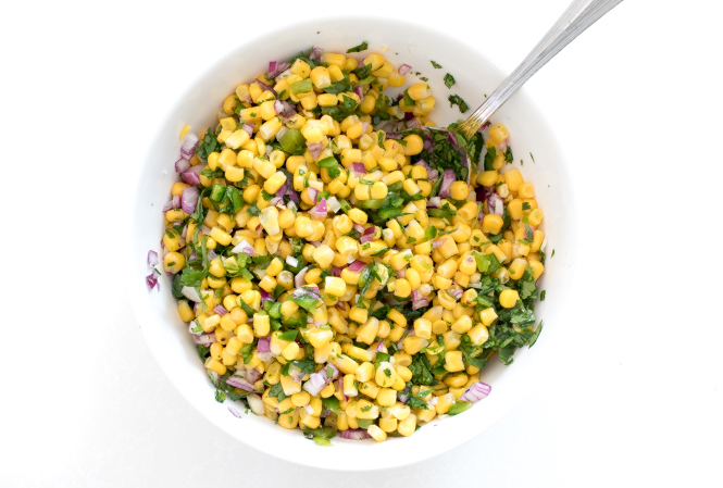 Copycat Chipotle Corn Salsa mixed together in white bowl