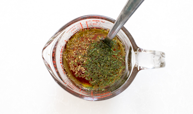 Vinaigrette in glass measuring cup