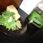In food processor mix olive oil, arugula, parmesan cheese, walnuts and lemon juice