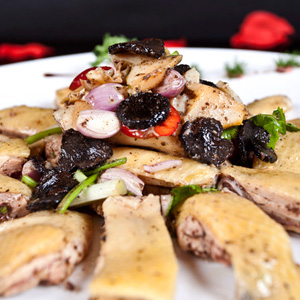 Marinated chicken trimmed with black truffle flakes