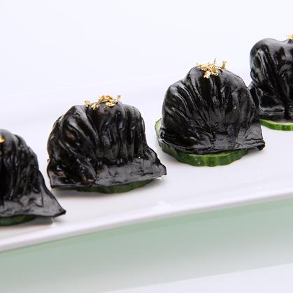 Steamed cuttlefish ink shrimp dumplings