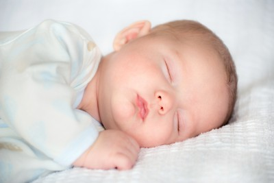 Infant baby boy sleeping peacefully