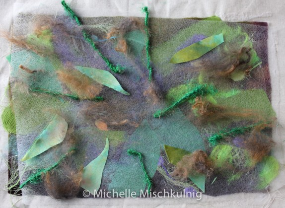 I then add a second layer of texture by laying another piece of fusible web on top of existing background.On top of the fusible web I place silk yarns,silk fibres and other fabrics and fuse together again.