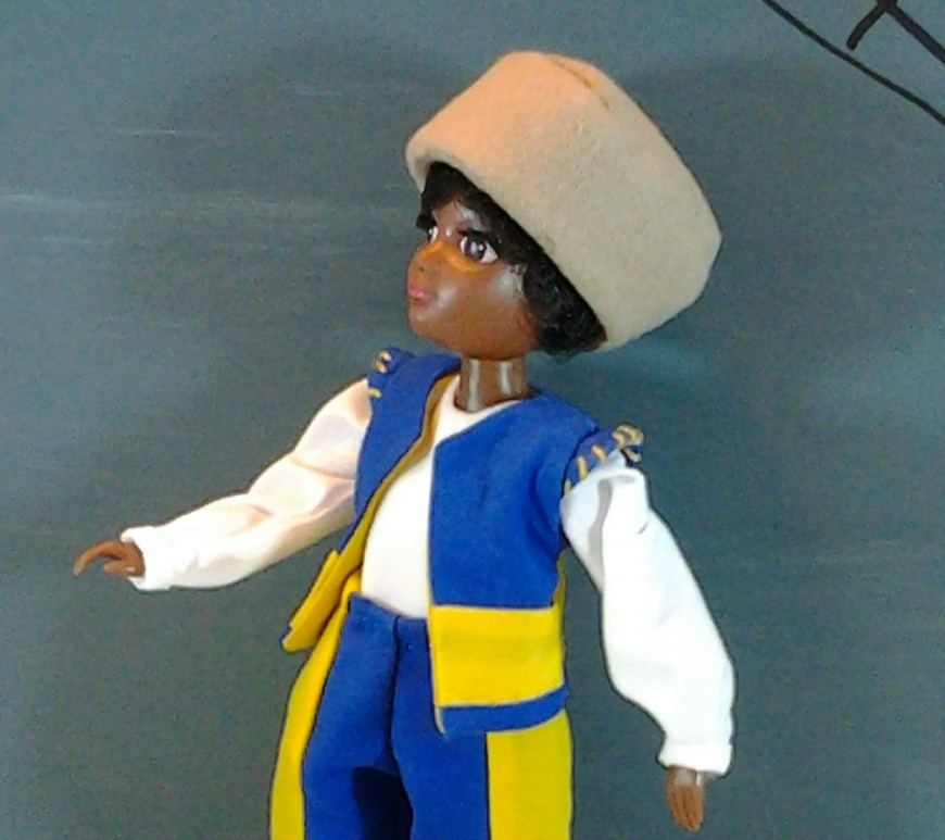 "Image of World of Love ""Soul"" doll in renaissance doublet (vest) with white long-sleeved shirt and simple hat"