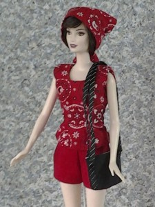 Image of Ashley Green doll from Twilight wearing a babushka style headscarf and carrying a doll-sized purse