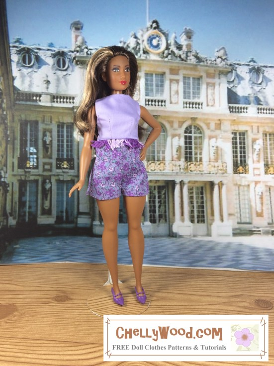 "Image of African American Curvy Barbie from Mattel's Fashionista  line ™ standing in front of the Palace at Verseille in a pair of handmade shorts and a crop top. Overlay says, ""chelly wood dot com: free printable sewing patterns and tutorials for doll clothes"""