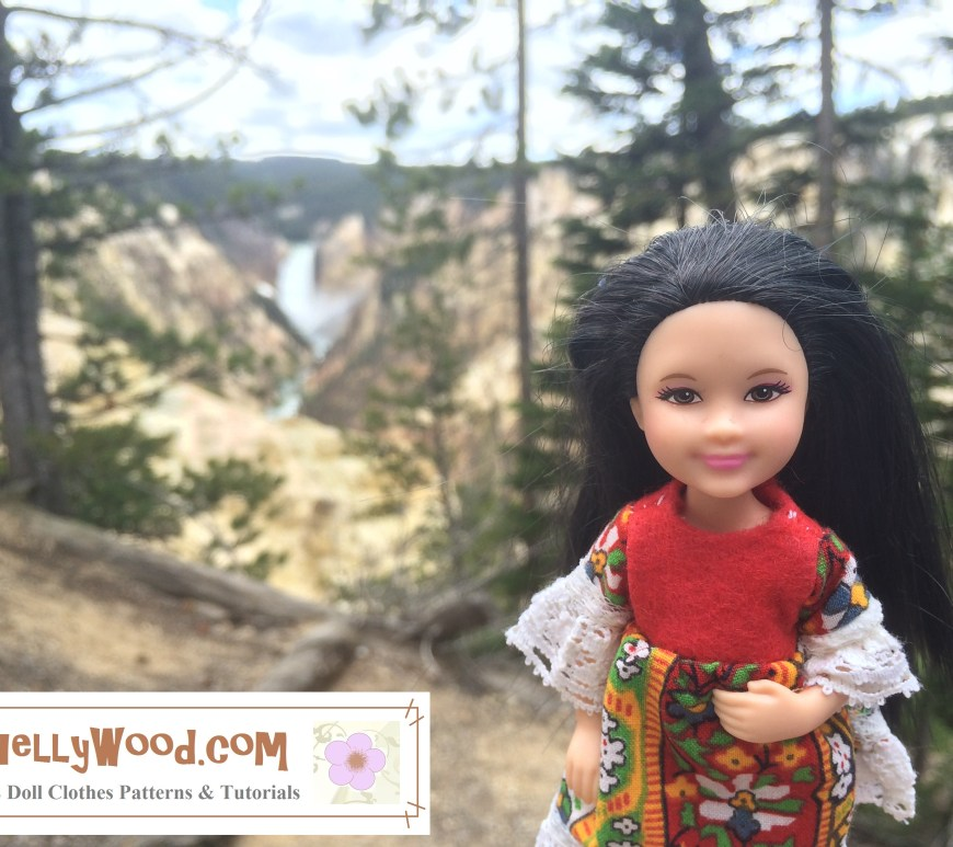Image shows Mattel's Chelsea (a trademarked name) doll dressed in a hand-made folk dress made with felt, lace, and folksy patterned fabric. She stands before a famous waterfall at Yellowstone Park. (The Doll was actually present at Yellowstone Park when this photo was taken. It's not a studio photo, but taken on-location.)