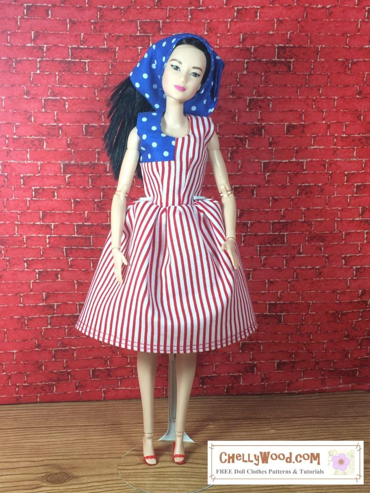 The image shows a lovely Made-to-Move Barbie wearing a color-block-style dress in two fabrics: one fabric is a blue cotton with white polka dots; the other fabric is a red and white striped fabric. So the dress looks a lot like a United States flag. If you'd like the free PDF sewing pattern for making this patriotic colorblock dress, please click on the link that's provided in the caption. Visit ChellyWood.com for all your free printable sewing patterns and tutorial videos for making doll clothes to fit dolls of many shapes and all different sizes!