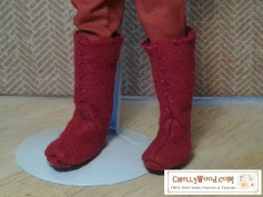 The photograph shows Ken doll feet in rust colored felt boots.