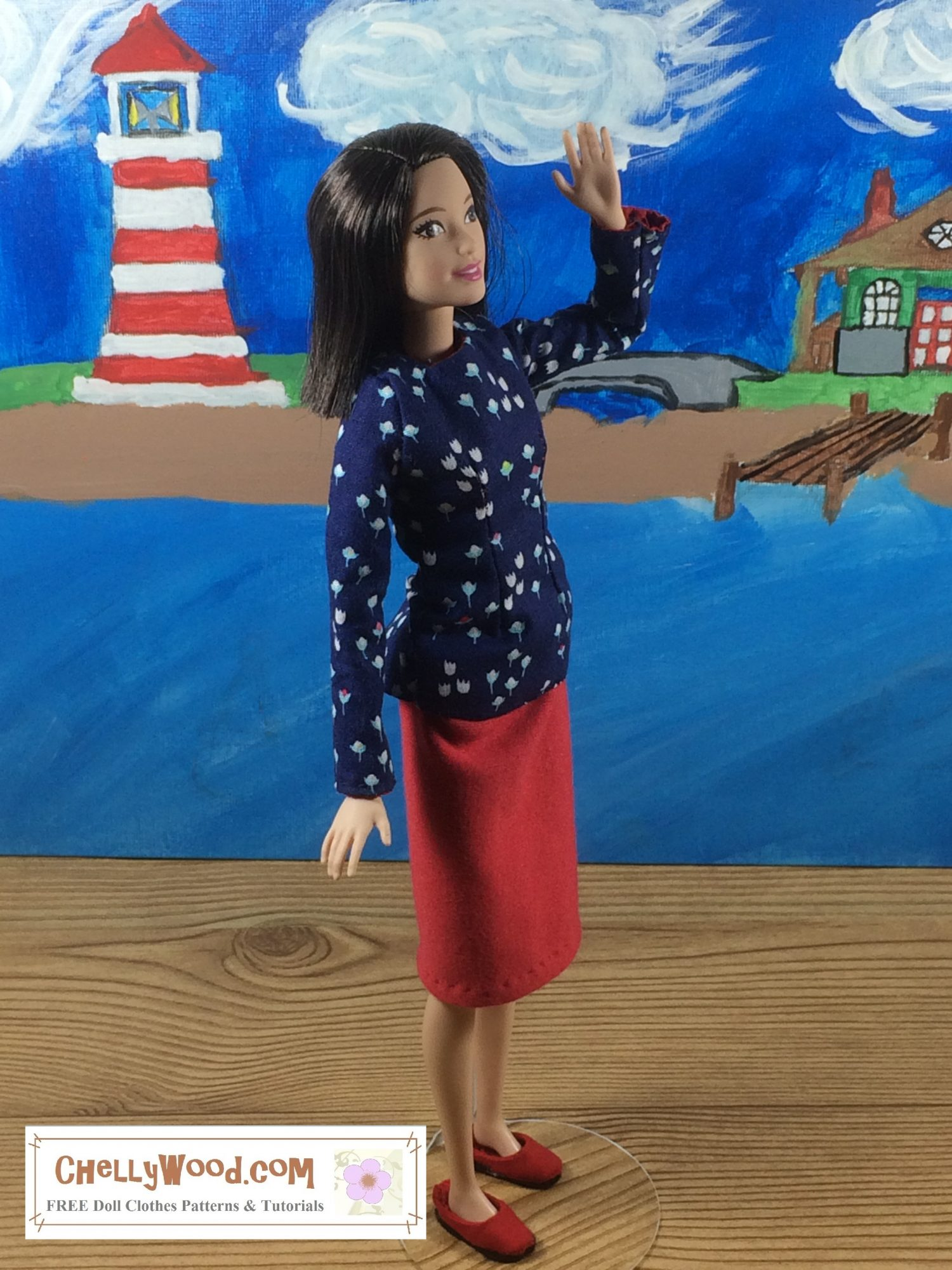 On a boardwalk near a beach, Tall Barbie stands waving to someone. She wears a navy blue floral long sleeved shirt made of cotton with a red jersey fabric pencil skirt.