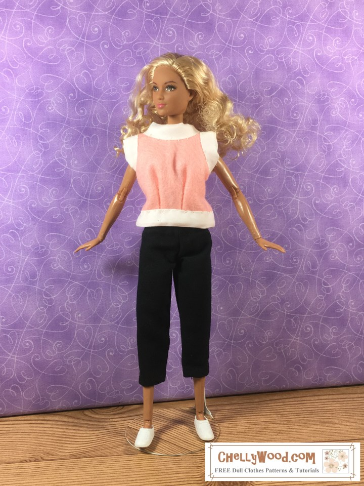 "Image shows Mattel's Made to Move Barbie wearing a hand-made felt shirt with bias tape trim. She also wears a pair of capri pants that are hand-made and little plastic sneakers (trainers). Overlay says, ""ChellyWood.com: Free doll clothes patterns and tutorials."""