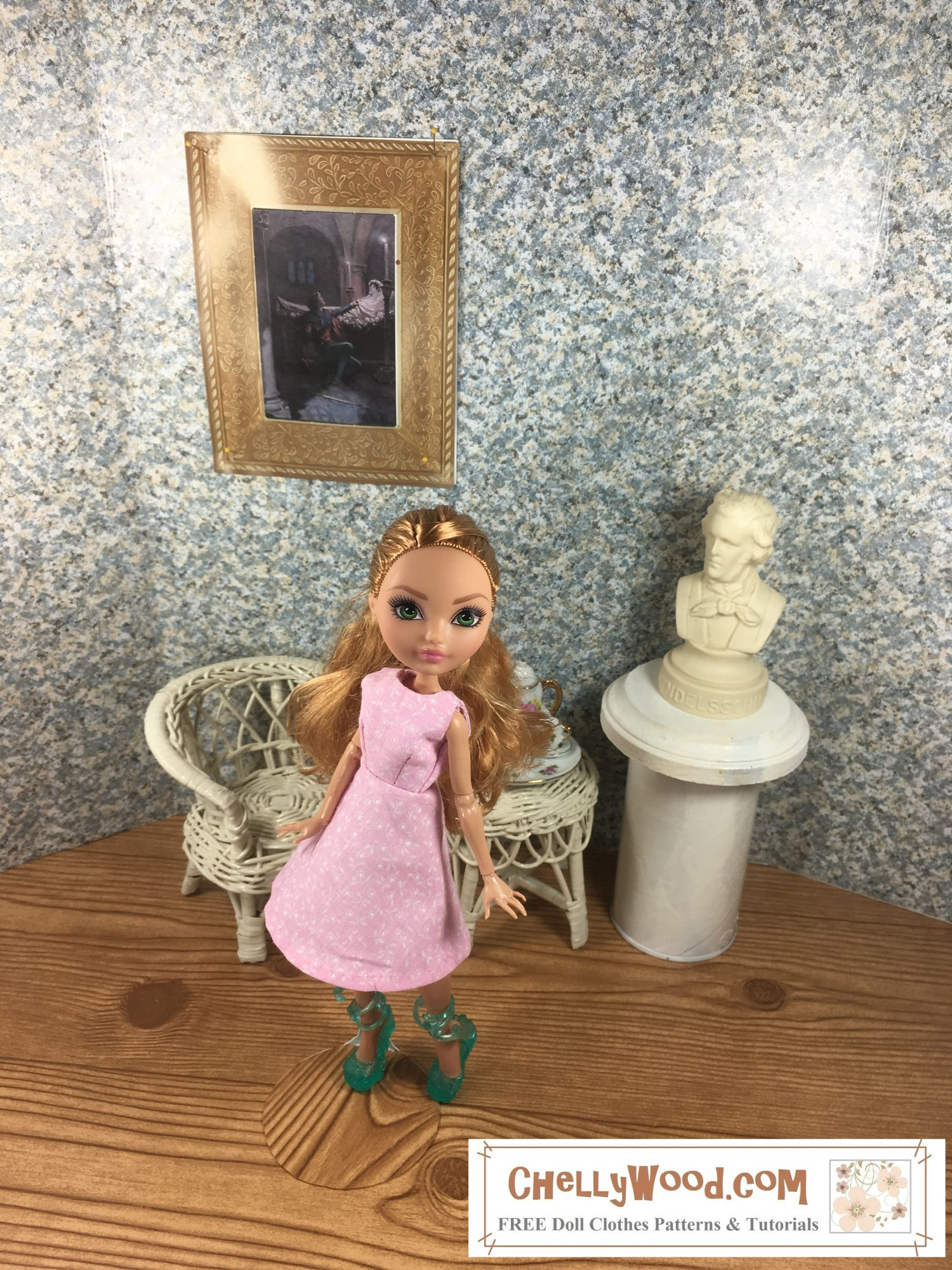 Here we see an Ever After High doll wearing a simple A line dress in a pink floral cotton print. She stands in an elegant ballroom with the bust of a composer nearby. Behind her is a wicker chair and on a wicker table sits a tiny tea set. there is a gold framed painting of Romeo and Juliet hanging on the wall.