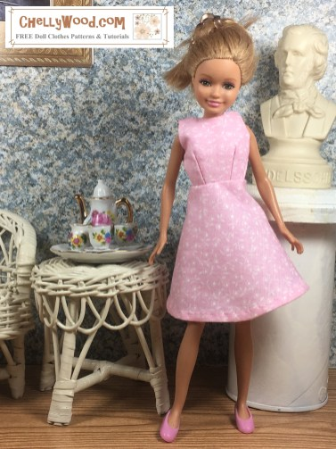 """Click here for all the patterns and tutorials you'll need to make this dress: https: https://wp.me/p1LmCj-GOj The image shows a Mattel Stacie doll wearing a handmade A-line sleeveless dress for 8"""" or 9"""" inch dolls like Stacie. In the diorama where the Stacie doll seems to stand at an angle, there's a tiny tea set on a wicker table, a wicker chair, and a bust of a musical composer resting on a pedestal. The patterns for making this A-line dress for Stacie are found at ChellyWood.com as a PDF downloadable sewing pattern. Chelly Wood designs free printable sewing patterns for making doll clothes to fit dolls of many shapes and sizes. Go to ChellyWood.com for both the PDF pattern and free tutorial video giving instructions for making this lovely dress which will fit Stacie dolls."""