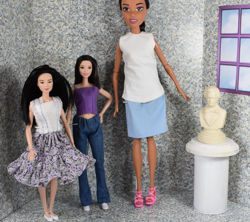 "Visit ChellyWood.com for FREE printable sewing patterns for dolls of many shapes and sizes. Image shows Mattel's Endless Hair Princess doll standing next to a fashionista tall barbie doll and a made to move ""regular"" sized Barbie. The article which accompanies this photo describes the exact measurements of the Endless Hair Princess doll in comparison to the fashionista brand of tall barbies from Mattel. The site, ChellyWood.com offers tips and tutorials and free patterns for people who enjoy sewing dolls' clothes. This particular article is about comparing the different dolls' dimensions for the purpose of sewing clothing for them."