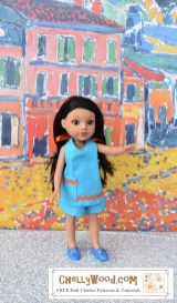 The image shows a Hearts for Hearts Girls doll wearing a blue halter top with rickrack trim and shorts. To access the free printable PDF sewing patterns and tutorial videos for making this outfit, please click on the link in the caption. This is a very versatile pattern, and it will fit dolls this size and bigger!