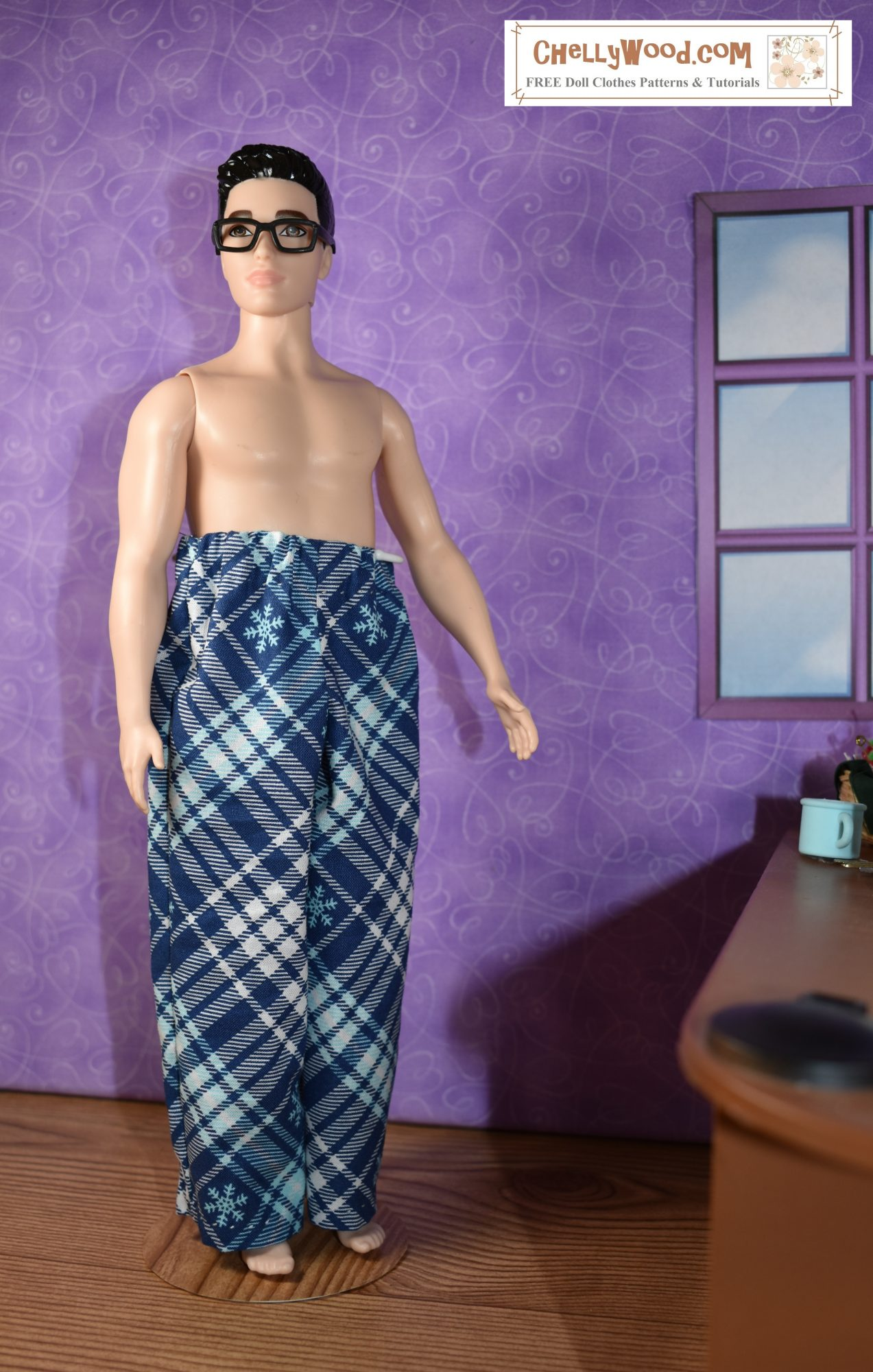 """The image shows Mattels """"Broad Ken"""" doll modeling a pair of plaid pajama pants made with a free printable sewing pattern found at ChellyWood.com"""