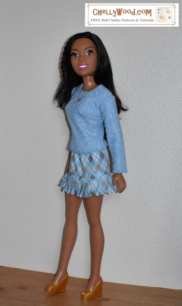 This image shows a 28 inch African American Best Fashion Friend Barbie wearing a handmade long sleeve sweater made of blue jersey curly faux fur fabric over a blue and tan cotton argyle mini skirt with knife pleats.