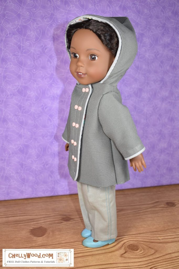 """Click on the link in the caption to make this raincoat. The image shows a Kendall Wellie Wisher doll wearing a raincoat with decorative ribbing and paired pink buttons. This is a hooded raincoat project. Please show your appreciation for Chelly Wood's free printable sewing patterns by honoring her """"Creative Commons Attribution"""" mark when you share images of this project and help promote her website on social media platforms."""