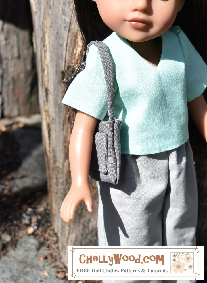 "The image shows a H4Hgirl doll with a strappy purse slung over her shoulder. the purse has a large pocket in one side. The overlay says, ""ChellyWood.com"" and suggests that the website mentioned offers free printable sewing patterns for dolls of many shapes and sizes."