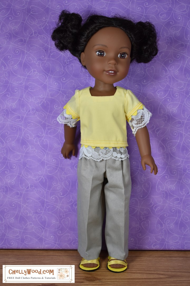 "The image shows a Wellie Wisher doll (Kendall from American Girl) wearing a handmade square-neck short sleeve blouse with lace at the sleeves and waist and khaki pants. Her handmade shoes are sandals made of craft foam and ribbon. At the bottom of the image, there's a URL for the website where you can print the free pattern for making this entire outfit: ChellyWood.com. The Chelly Wood website's motto is ""free doll clothes patterns and tutorials for dolls of many shapes and sizes."" Patterns are offered as a PDF download and a MS Word document, for easy printing."