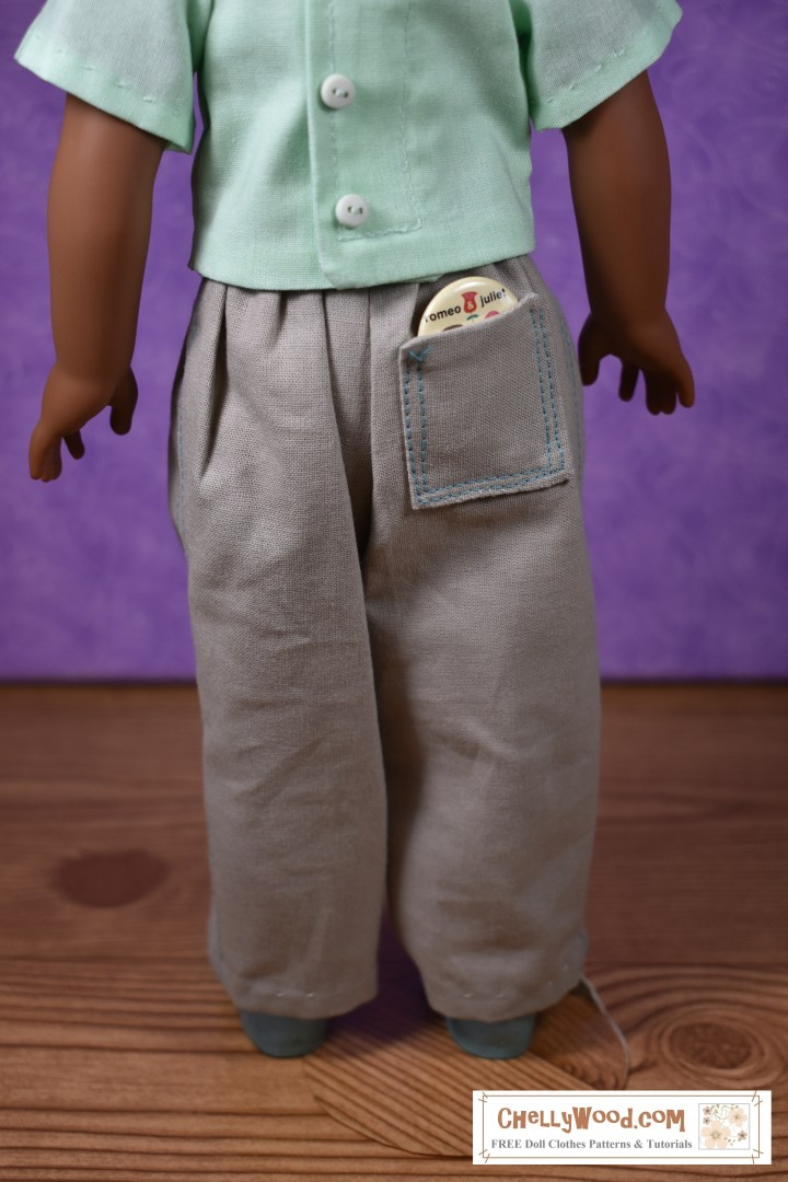 The image shows a Kendall Wellie Wisher doll wearing a pair of handmade doll pants. The free printable pdf pattern for making these 15 inch doll pants is found at ChellyWood.com (the URL is provided on the image). These pants can be made with top stitch decorations and a back pocket. Free tutorial videos are available to show you how to sew them.