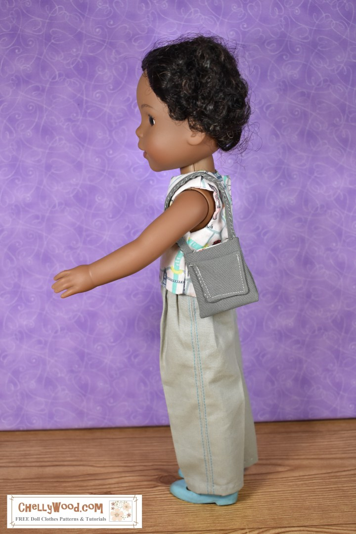 "The image shows a Wellie Wisher doll (Kendall from American Girl) wearing a handmade round-neck sleeveless reversible top and khaki pants. She is turned sideways so the top stitching, which runs from the waist of her pants to the hem, is visible. She holds a handmade purse with a pocket. At the bottom of the image, there's a URL for the website where you can print the free pattern for making this entire outfit: ChellyWood.com. The Chelly Wood website's motto is ""free doll clothes patterns and tutorials for dolls of many shapes and sizes."" Patterns are offered as a PDF download and a MS Word document, for easy printing."