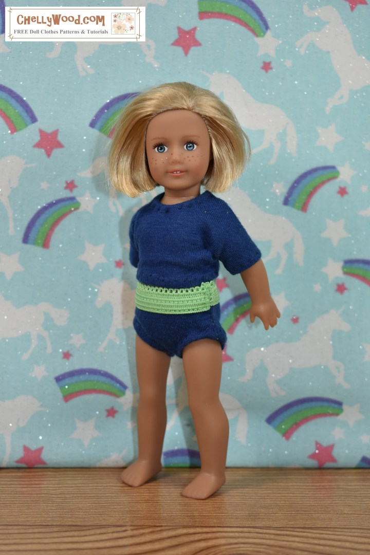 """The image shows a 6-inch American Girl doll modeling a pair of handmade briefs (underpants / knickers) with a handmade T-shirt (tee shirt). The watermark says """"ChellyWood.com"""" which is the URL of the website where you can download free printable sewing patterns for doll clothes, including this pair of underpants and this shirt pattern for 6 inch dolls like American Girl. In this image, you can see the side seam where the underpants have been sewn together along the outseam."""