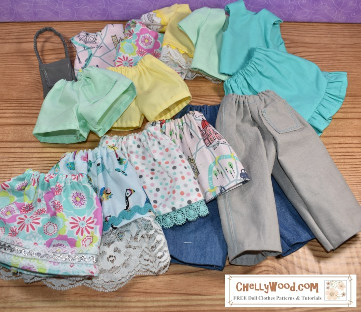 The image shows a series of doll clothes laid out on a tabletop so you can see the variety of colors and prints in the fabrics. The clothes include five skirts, two pair of pants, two pair of shorts, five shirts, and a purse. The free printable sewing patterns for these doll clothes can be found at ChellyWood.com