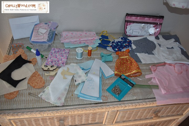 The image shows doll clothes sewing projects in various stages of completion. The overlay offers the name of the website where you can download lots of free printable sewing patterns for dolls of many shapes and sizes: ChellyWood.com