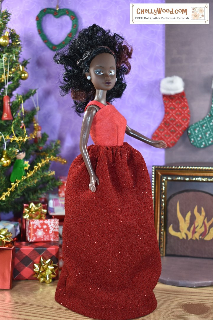 The image shows Azeezah, one of the Queens of Africa dolls from the Slice by Cake company. She models a sparkly red skirt and a red felt top with easy-to-sew straps. If you click on the link in the caption, it will take you to a page where you can download and print all the FREE PDF sewing patterns you'll need to make this outfit, and it will also offer sewing tutorials explaining how to follow the patterns to make the outfit. This image comes from the website ChellyWood.com where you can find hundreds of free printable sewing patterns for doll clothes and crafts.