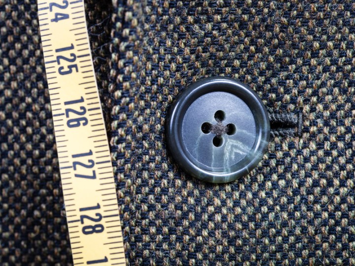 "This image is part of a blog post that answers the question: ""What is seam allowance used for?"" The blog post is found at ChellyWood.com and you can use the search tool to locate that blog post. The image shows a tape measure superimposed over tweed fabric with a button sewn on it."