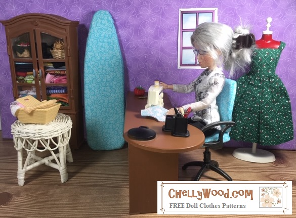 """The image shows a 1:6 scale sewing room, complete with a sewing desk, sewing machine, ironing board with miniature ironing board cover, dress form, cabinetry, and a little window. A doll sits at the sewing machine. She appears to be sewing a floral bodice. The watermark says: """"Chelly Wood dot com ... Free doll clothes patterns."""""""